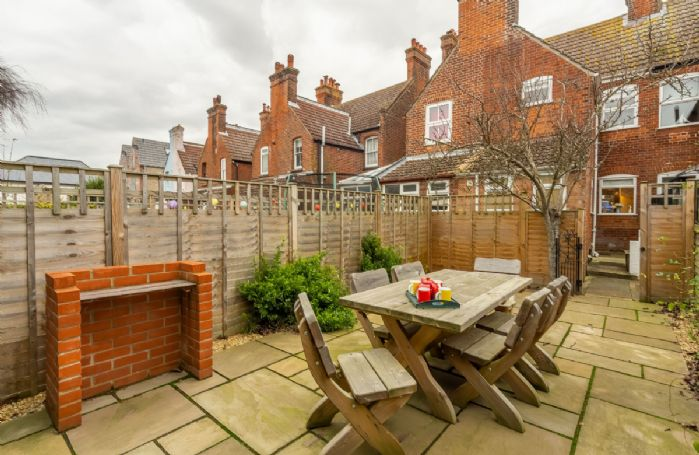 To the rear of Number 22 is the fully enclosed courtyard garden with garden furniture and brick built barbecue