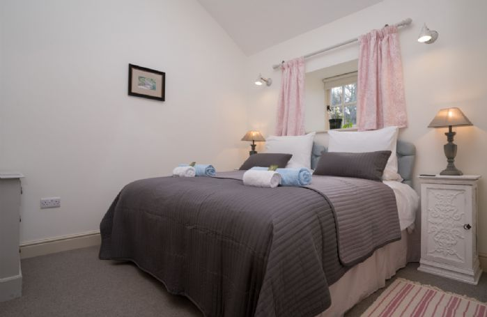 Ground floor: Large bedroom with double bed (can be converted into twin beds on request)