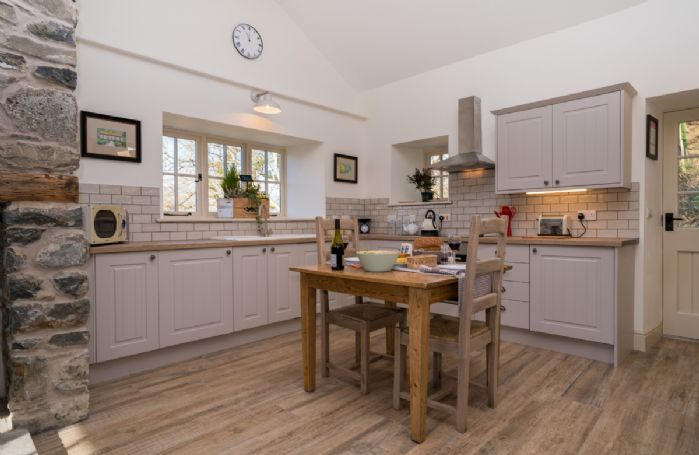 Ground floor: Fully fitted kitchen and dining table for two
