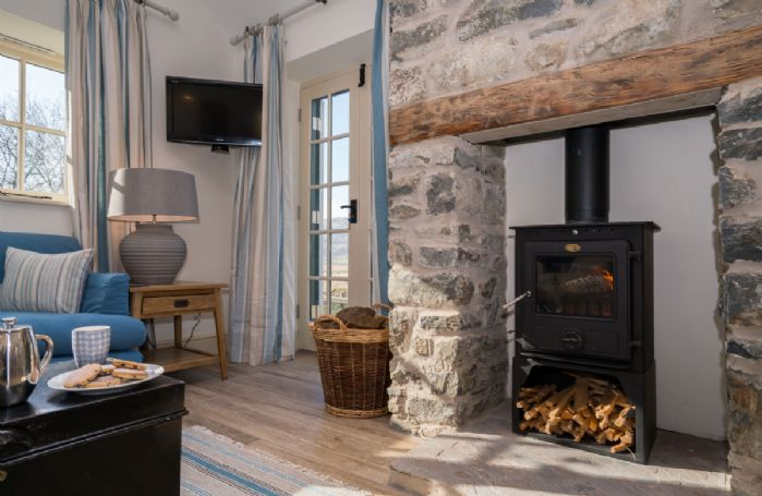 Enjoy a warming fire by the woodburner on a chilly afternoon