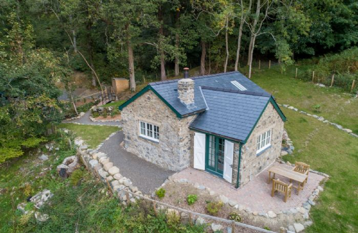 Nestled in the woods lies this beautiful little cottage with private garden