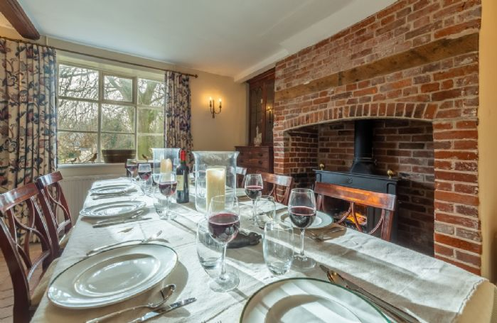 Ground floor: Dining room with seating for eight guests and wood burning stove