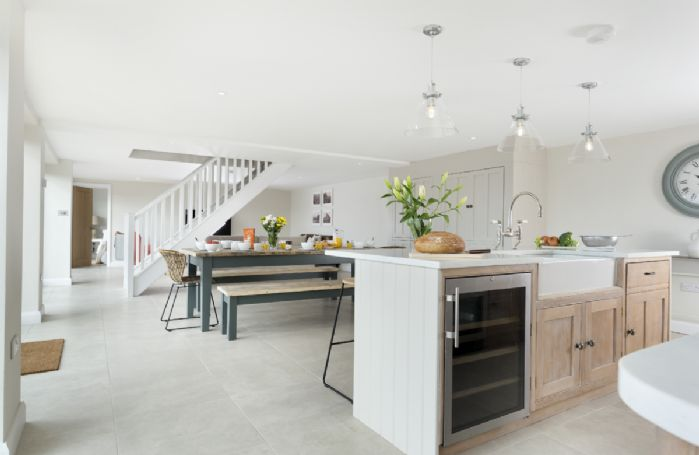 Ground floor: Open-plan living area with kitchen, dining area and sitting room
