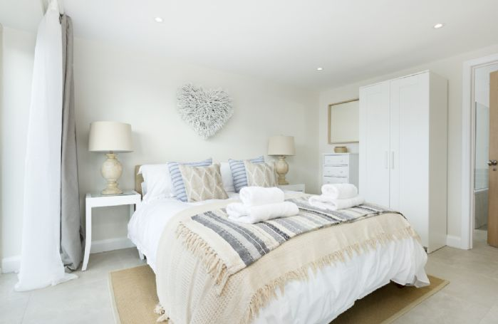 Ground floor: A stylish king-size bedroom