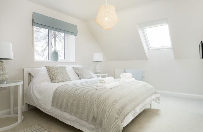 First floor: King-size bedroom with soothing interiors