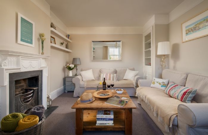 Ground floor: Spacious sitting room with two sofas and television