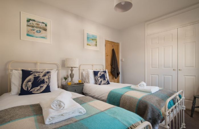First floor: Bedroom with two 3' single beds