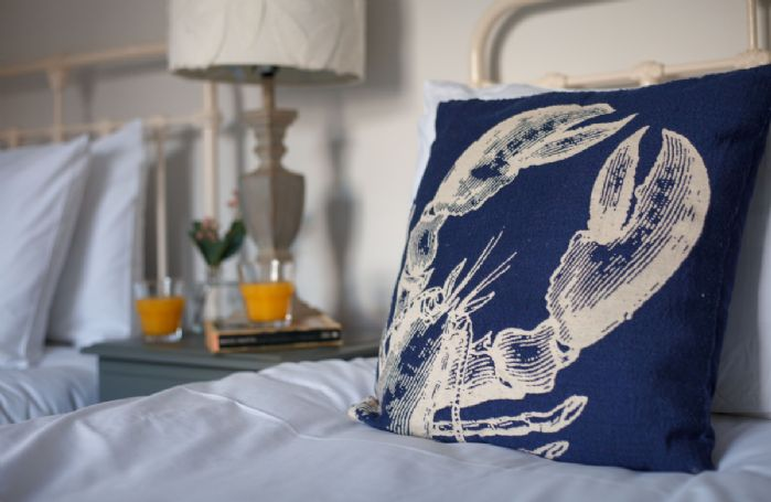 The twin bedroom features a nautical theme
