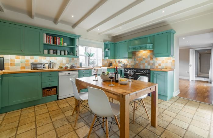 Ground floor: Large well-equipped kitchen with table and chairs for four