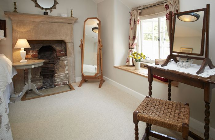 First floor: Double bedroom with dressing table and window seat
