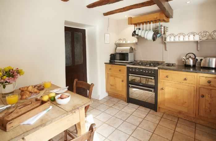Ground floor: Kitchen and dining room with traditional wooden beams