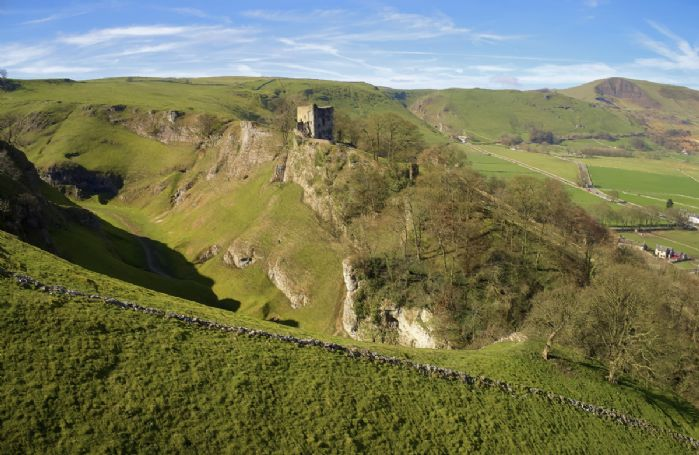 The imposing ruins of Peveril Castle stand high above the pretty village of Castleton