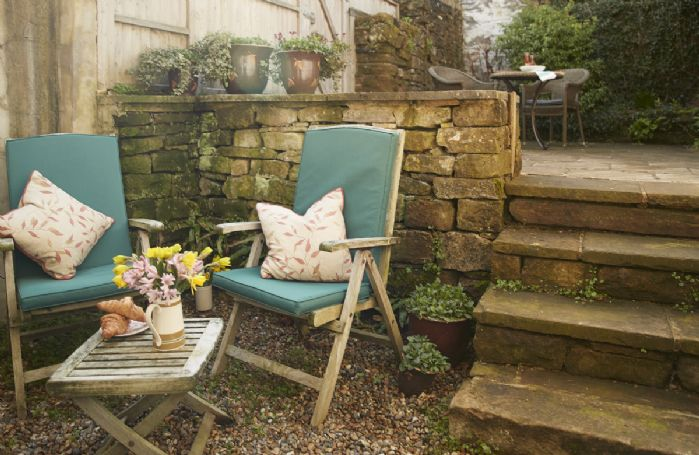 Additional seating in the courtyard perfect for relaxing at the cottage