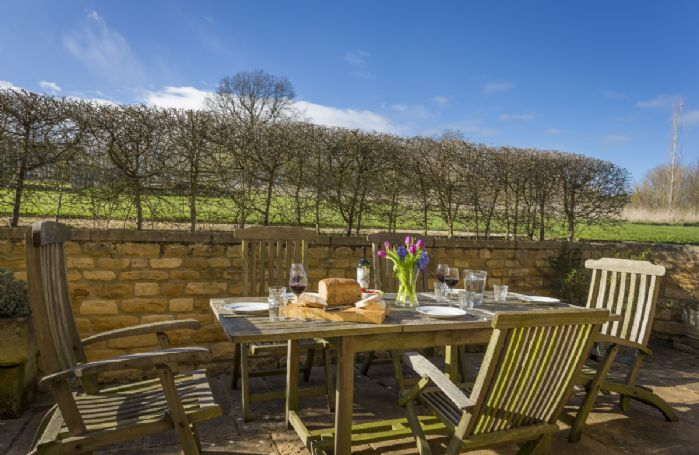 The rear patio terrace is ideal for outdoor dining