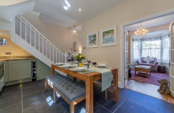 Ground floor: Dining table, french doors leading into sitting room and stairs to first floor