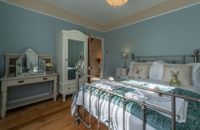 First floor: Beautifully furnished double room with 4'6 bed and dressing table