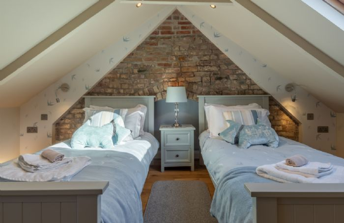 Second floor: Charming twin beds on the top floor with pitched roof