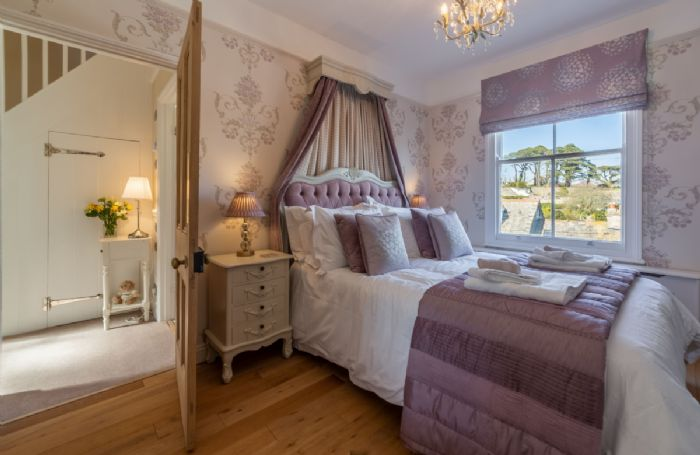First floor: Spacious master bedroom with 4'6 double bed and stunning estuary views