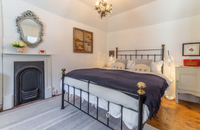 Bedroom with 5' cast iron bed