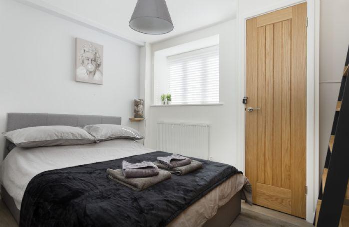 Ground floor: Bedroom one with 4'6 double bed
