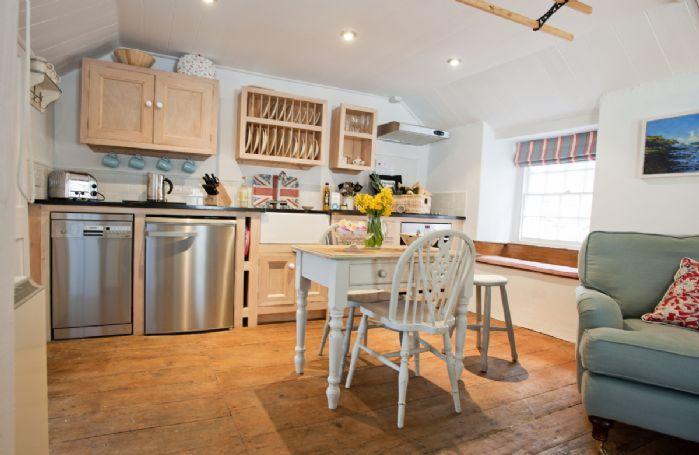 Handmade wooden galley kitchen with granite worktops