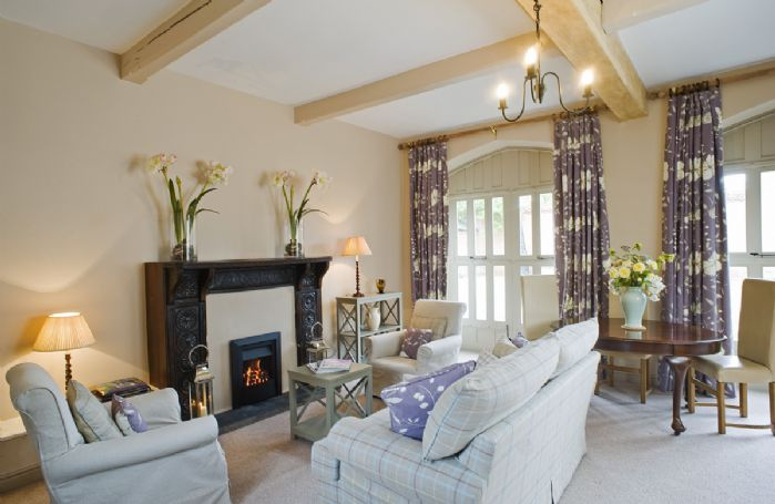 Ground floor: The cottage has an impressive carved fireplace which surrounds a gas fire