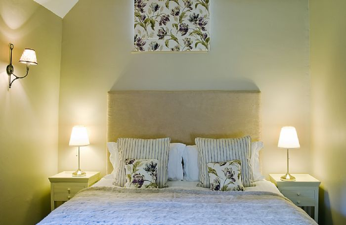 First floor: Double bedroom with super king size bed and dressing table
