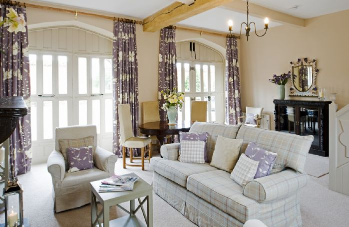 Ground floor: The sitting room with dining area is a spacious room featuring high ceilings