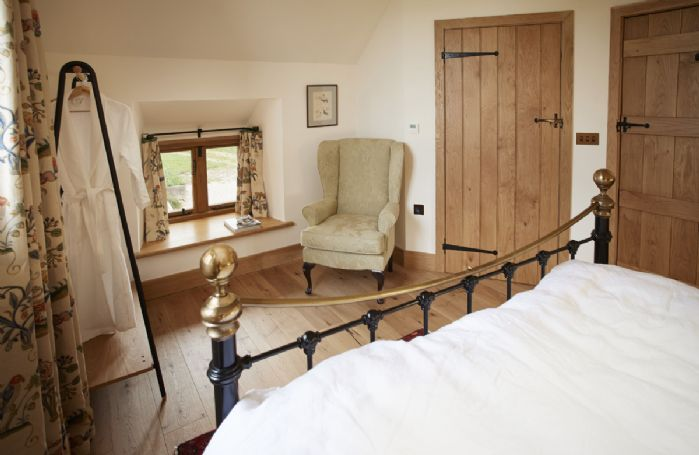 First floor: The Tudor bedroom with 5' king size bed and en-suite shower room