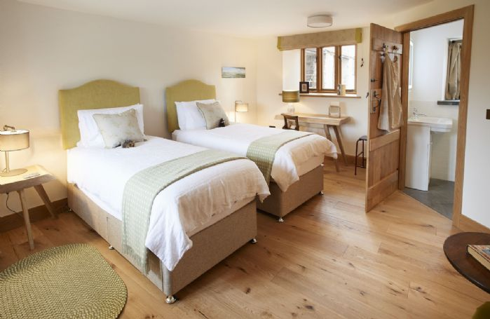 Ground floor: The Garden bedroom with zip and link bed that can be configured as a super king or two single beds