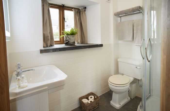 Ground floor: En-suite shower to the garden bedroom