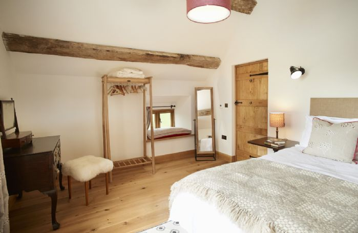 First floor: The Orchard master bedroom with 5' king size bed and adjoining bathroom