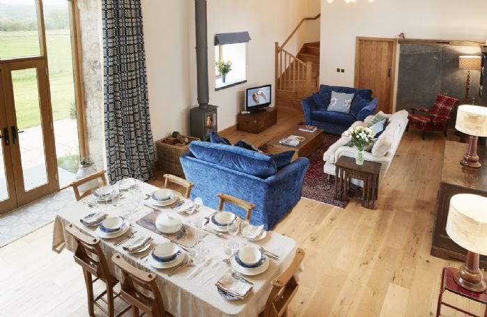 Ground floor: Open plan living and dining area with wood burning stove