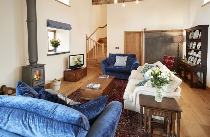 Ground floor: The spacious living area is filled with light and its own wood burning stove
