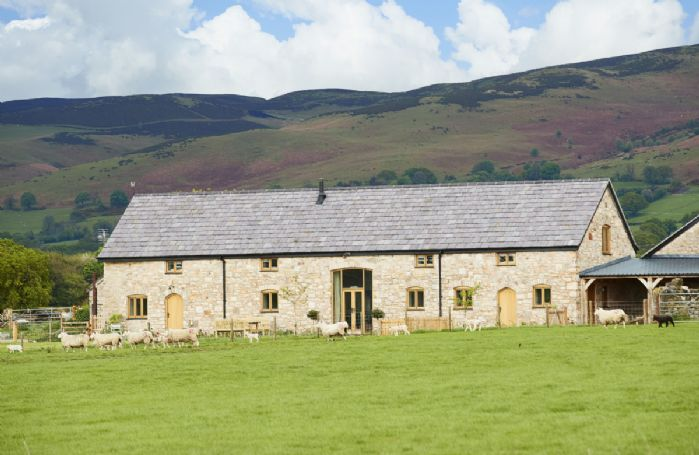 The Longbarn at Caerfallen is a Grade II listed luxury home with stunning views