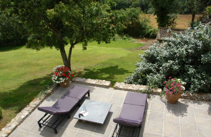 The Artist's Studio boasts a delightful south facing terrace, ideal for relaxing in the sunshine