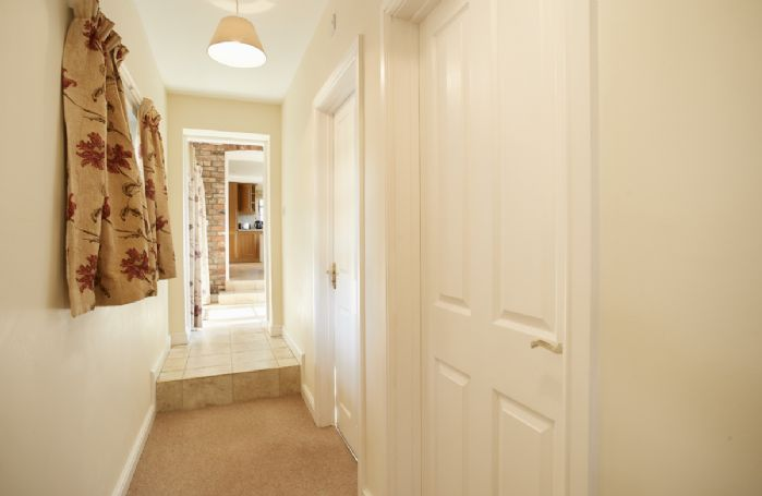 Ground floor: Hallway leading to the master bedroom and single bedroom