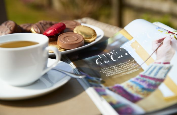 Enjoy a freshly brewed tea and delicious biscuits in the garden