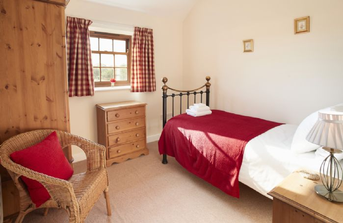 Ground floor: A charming single bedroom with 3' bed