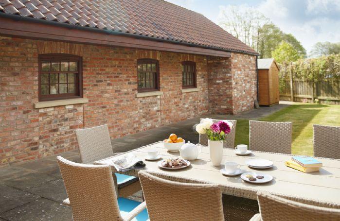 Enjoy dining al fresco in the rear enclosed garden patio