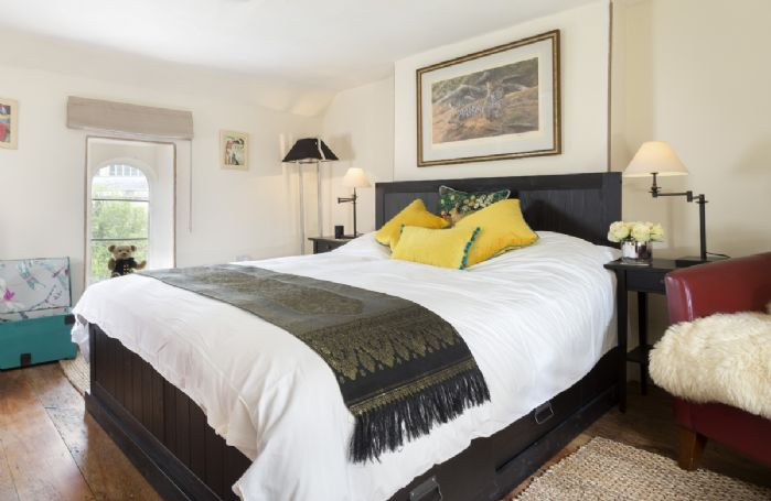 First floor: Spacious double bedroom with king-size bed