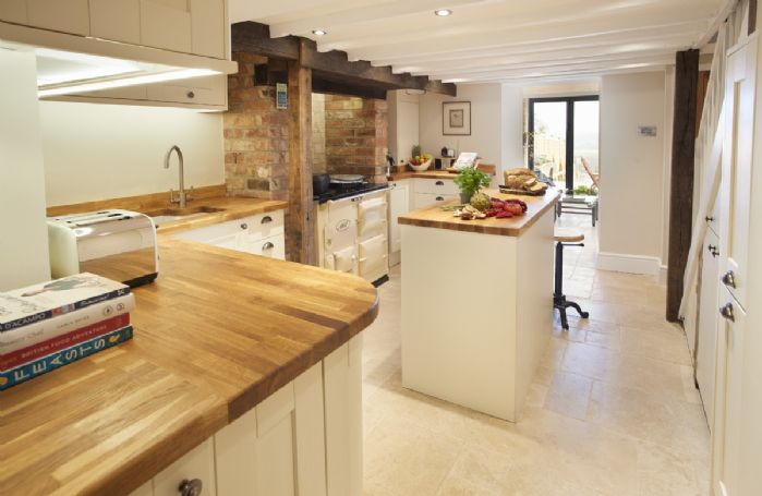 Lower ground floor:  The kitchen flows through to the light and airy garden room