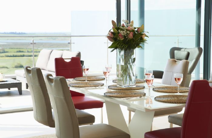Second floor: Modern and stylish dining table seating six guests