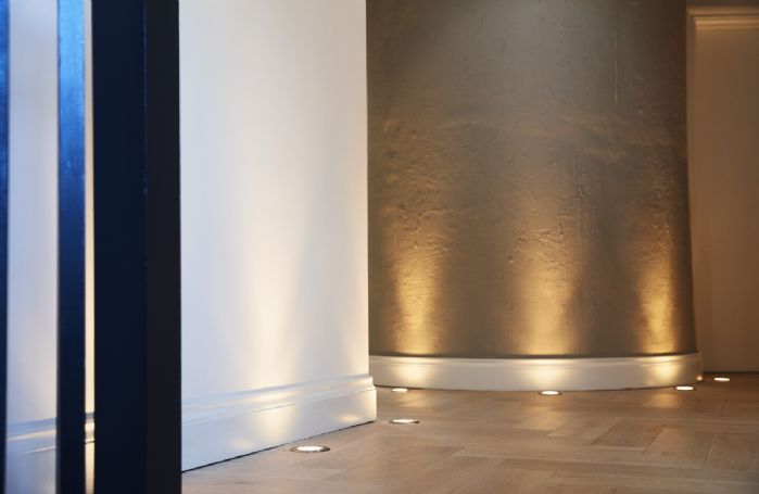 Subtle touches like floor lighting and underfloor heating throughout add to the elegance