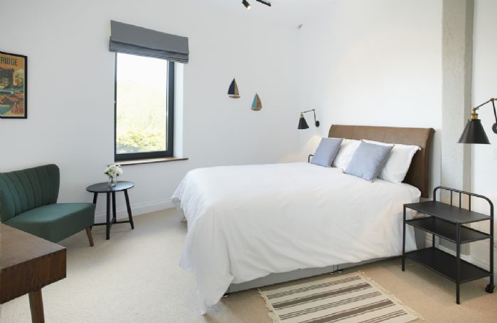 First floor: Spacious double bedroom with lots of natural light