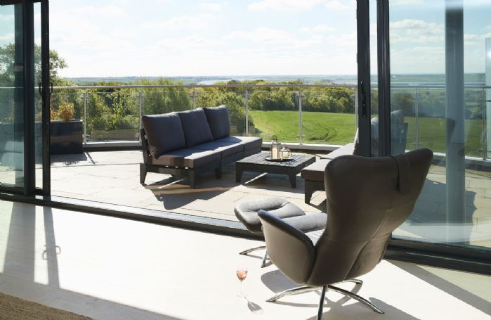 Second floor: Take the sun in from the comfort of the sitting room with glass doors open