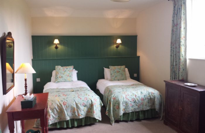 First floor: The twin bedroom has specially designed beds (can be converted into twin beds on request) and original furniture
