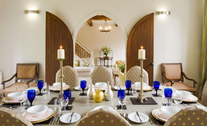 Ground floor: The dining room table, set for 8, can be extended to seat up to 16 persons