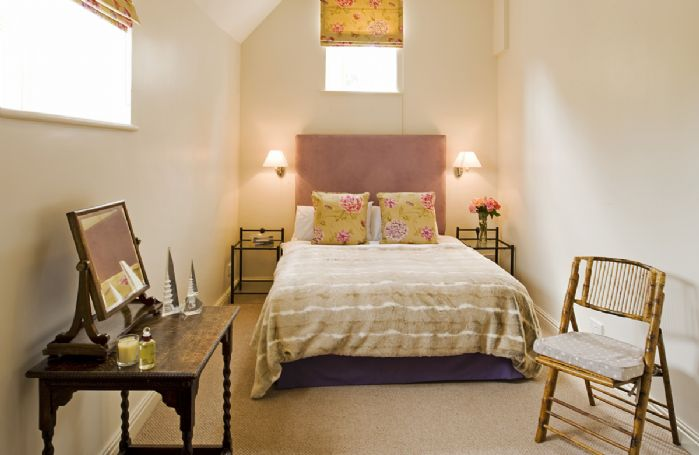 First floor: Comfortable double bedroom with plenty of natural light
