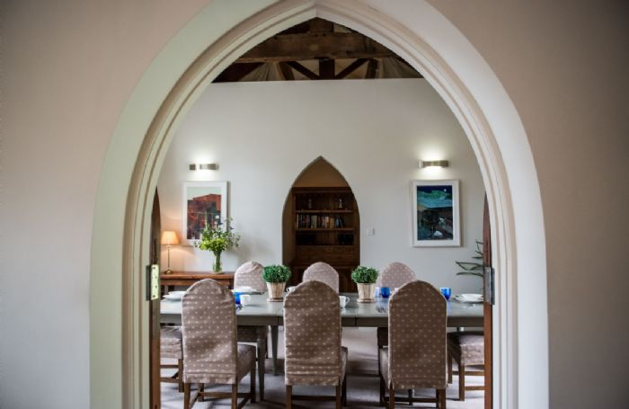 Ground floor: Through the Gothic arch in the dining room sits a Gothic dresser
